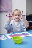 Girl finger_painting in classroom