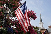 Detail of American flag and lamppost in Market Square on King Street in Old Town, Alexandria, Virginia, USA