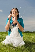 Woman blowing bubbles (thumbnail)