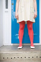 Woman in tights standing on doorstep