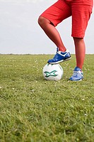 Female footballer in a field