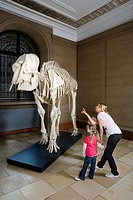 Mother and children looking at an elephant skeleton