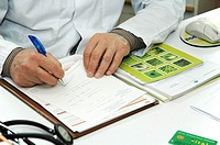 PRESCRIPTION A respirologist is writing a medical prescription.