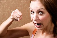 Angry Woman Throwing a Punch