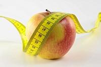 ein Apfel und ein Maßband