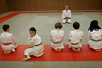 14_year_old teenager girl with down´s syndrome during a judo class with other valid children.
