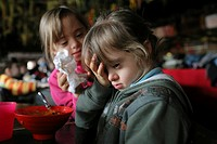 6_year_old twin sisters with down´s syndrome during a trip at Disneyland Resort Paris organized by the leisure centre Loisirs Pluriels that have the a...