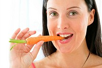 WOMAN EATING RAW VEGETABLES Model.