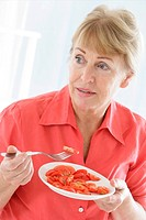 ELDERLY P EATING RAW VEGETABLES Model. 60_year_old woman.