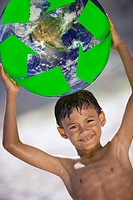 Boy holding globe above head