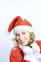 Happy young woman in Santa´s suit