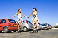 Young women with inline skates