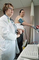 EXERCISE ECG Photo essay from hospital. Cardiac stress test on a treadmill.