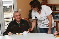HOME FOR THE AGED Photo essay in a nursing home for the elderly in the department of Aisne, France. Nurse´s aide with a retired man having his afterno...