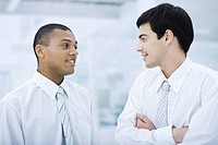 Two young businessmen chatting