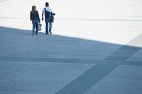 Couple walking together across public square (thumbnail)