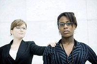 Businesswoman tapping associate on shoulder (thumbnail)
