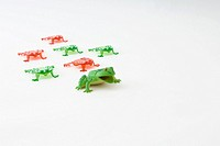 Toy frog leading group of smaller plastic frogs