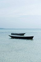 Pair of empty boats floating next to each other, Zanzibar, Tanzania