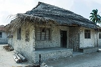 Tanzania, Zanzibar, house made of stone with thatched roof