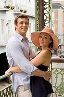 Couple embracing on balcony