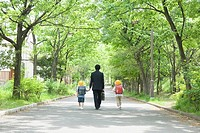 Father with Two Children Walking Down Street