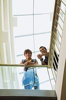 Teen boys leaning on railing