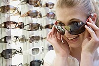 Teen girl trying on sunglasses