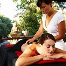 Woman receiving hot stone massage