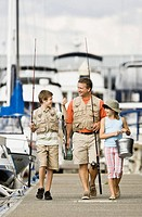 Man and children on dock with fishing gear