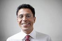 Smiling businessman with eyeglasses
