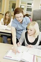 Teacher helping high school student