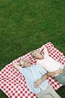 Couple relaxing on a lawn