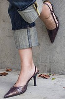 Woman in high heels and cropped pants