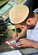 man writing in arabic