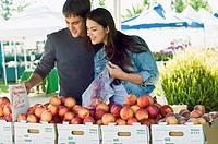 Couple shopping for nectarines