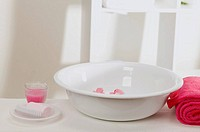 Wash bowl with flowers, soap, towel and candle in glass (thumbnail)