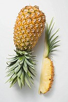 Whole pineapple with wedge of pineapple (thumbnail)