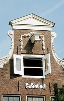 Front of a seventeenth century town house beside a canal, Amsterdam, Holland