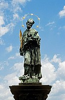 Statue of Saint John of Nepomuk holding Christ on cross, Charles Bridge, Karluv Most, Prague, Czech Republic