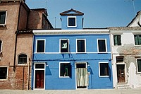 Blue painted houses, typical of island of Burano, Burano, Venice, Italy