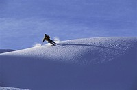 Snow skier on snowy hillside