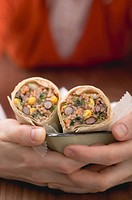 Woman holding bean burritos