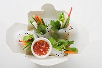 Rice paper rolls with vegetables & sauce in take_away container