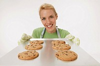 Woman with tray of cookies