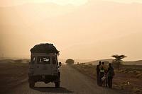 Morocco, Between Zagora and Tata, Land Rover driving along dusty road