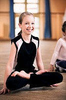portrait of young girl doing meditation exercise
