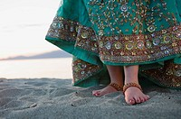 Feet of a Woman in a Choli Traditional Dress on a Beach