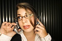 Businesswoman on cell phones