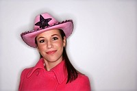 Teenage girl posing in cowboy hat